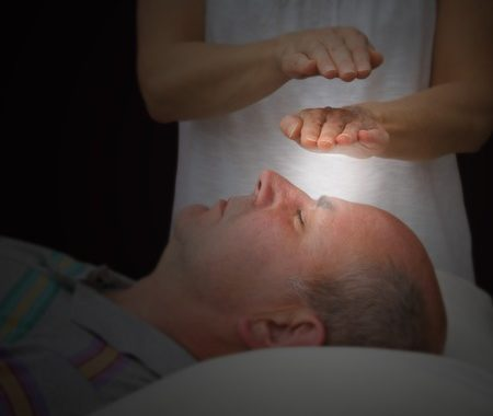 31971642 - Healer Sensing Aura Levels Over Third Eye Chakra