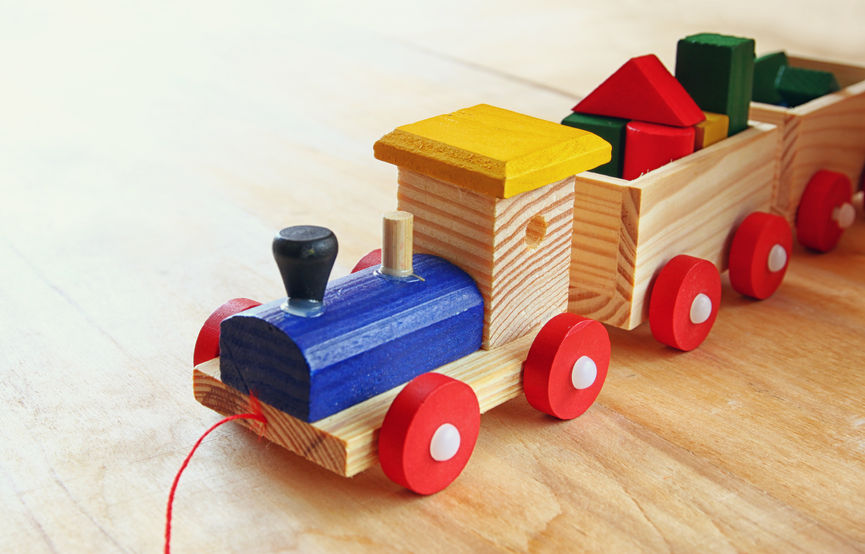 Close Up Of Wooden Toy Train Over Wooden Table. Selective Focus. Retro Filtered