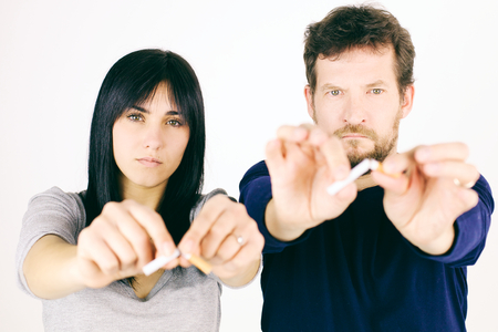 36288313 - Serious Couple Deciding To Stop Smoking